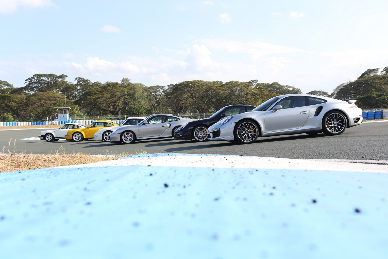 Driving 6 Generations of the Porsche 911 Turbo on Track